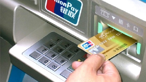 China limits overseas UnionPay cash withdrawals