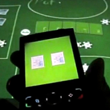 Play poker WITH, not just ON, your mobile phone