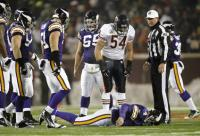 Urlacher Stands over Favre