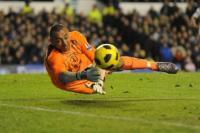 Tottenham's Heurelho Gomes makes a save