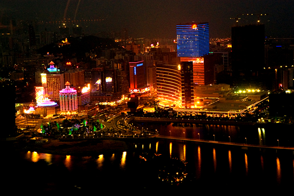 Macau estimates cut by analysts; Cotai developments have to demonstrate non-gaming commitment; Wynn files new suit