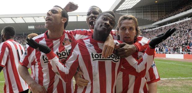 Asamoah Gyan celebrates
