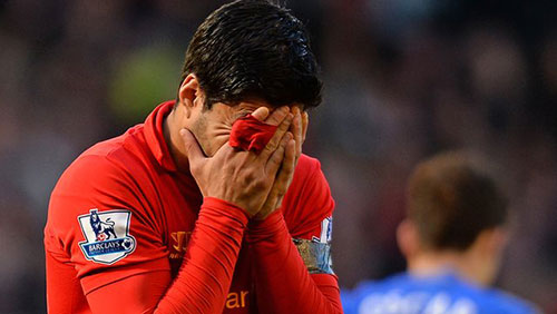Luis Suarez receives a 10-match ban after biting the Chelsea defender Branislav Ivanovic