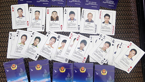 Chinese Cybercrime Mugshots on Deck of Cards; Gambling Den Earning Millions Rumbled by Police