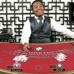 Video appears to show BetOnline live blackjack dealer cheating