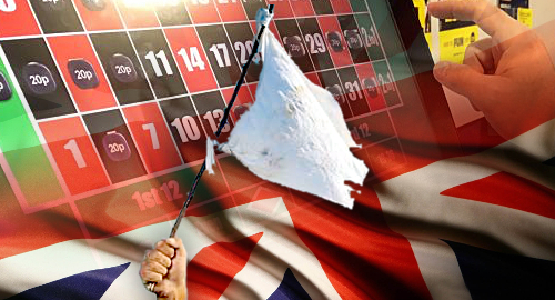 UK gov't caves, advances FOBT stake cut, online casino tax hike