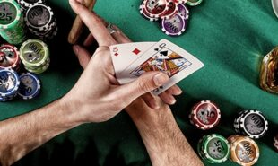 Poker player holding cards