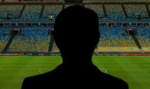 Silhouette of a coach with soccer field on the background