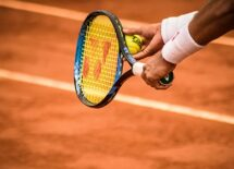 Photo of a tennis player's hand about to serve the ball