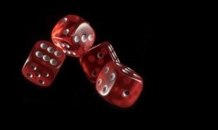 Shot of dice thrown. Concept of gambling