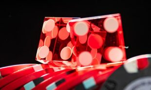 Zoomed photo of dice over poker chips. Concept of gambling