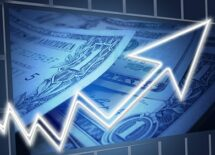 Image of an upward arrow against a background of US dollars. Concept of business profit