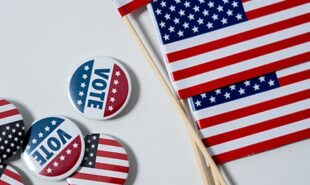 Vote pins and American Flags. Concept of Voting and Election