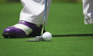 Zoomed photo of a player about to hit the golf ball