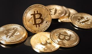 Photo of Bitcoins on top of a black surface