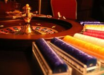 Photo of a roulette and poker chips. Concept of gambling