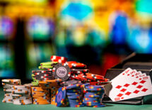 Stacks of poker chips and cards with a blurry casino background. Concept of gambling