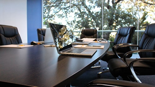 Photo of an office boardroom. Concept of shareholder's meeting