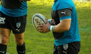 Rugby player holding a rugby ball