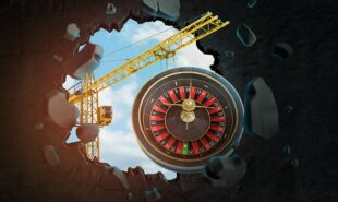 3d rendering of construction crane and casino roulette seen through gap in black wall. concept of casino construction