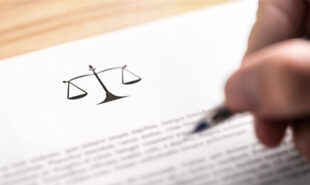 Person writing on a legal paper. concept of lawsuit