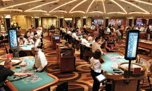 People playing at a casino place