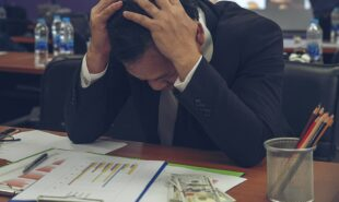 Businessman struggling Financial Report