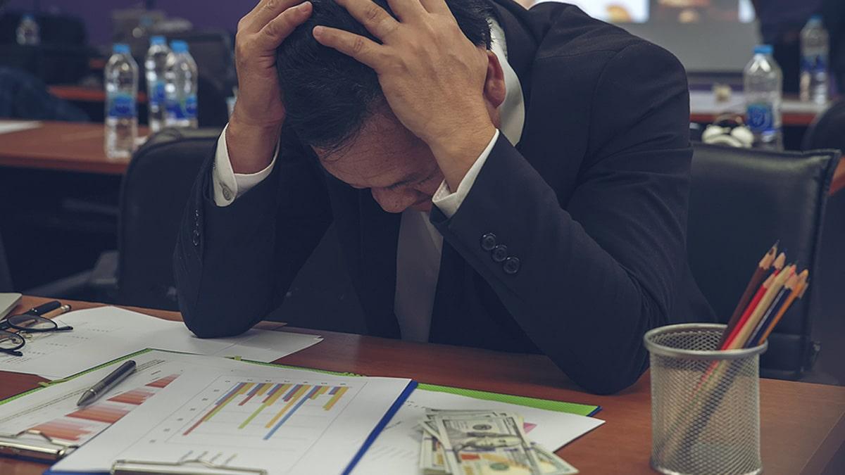Businessman struggling Financial Report