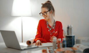 A girl dressed red, working from home
