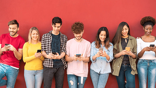 Group of friends using mobile smartphone
