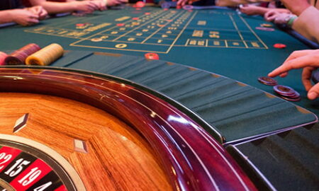 Roulette table with people playing