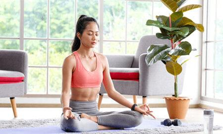 Women meditating at home
