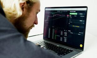 Man checking the stock market updates
