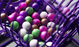 Purple lottery game in close-up with different colored balls with numbers