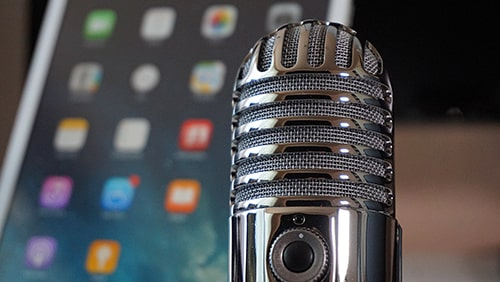 Close-up of a microphone against a blurred background of a tablet