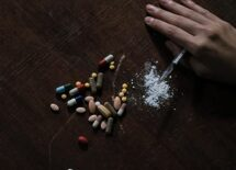 Top view of different drugs on a wooden table