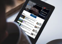A man browsing CalvinAyre website on a tablet