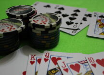 Photo of some casino chips and playing cards