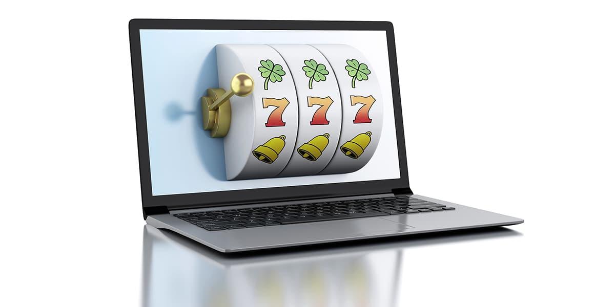 3d render illustration. Laptop with slot machine. Casino online games concept.