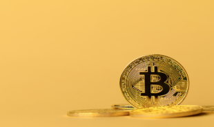 gold-bitcoin-cryptocurrency-coins-on-yellow