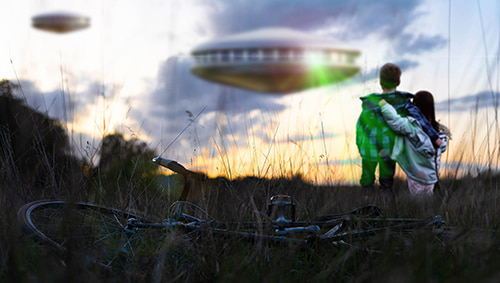 Two children staring at some unidentified flying objects in the sky