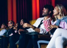 Group of audience happy and fun watch cinema in movie theater.