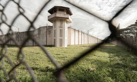 Prison with iron fences.