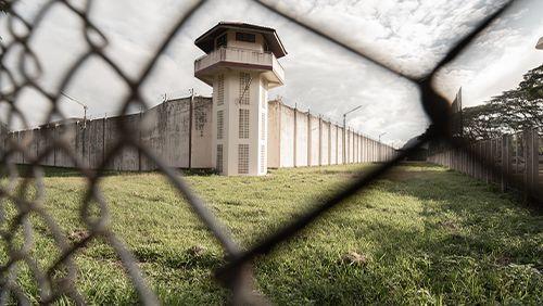 Prison with iron fences.