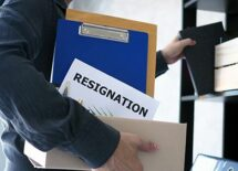 businessman cleaning his office with resignation letter inside his box