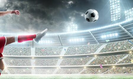 soccer ball being kicked across the field