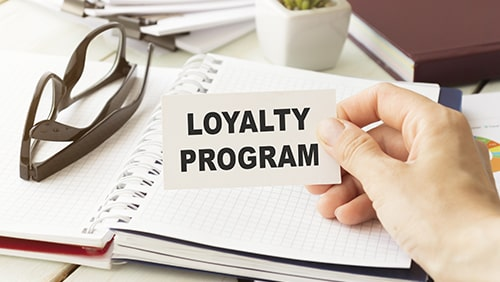 Loyalty Program card with urban background, business concept