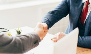 Zoomed photo of business men shaking hands