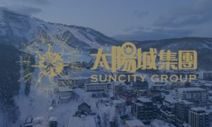 Logo of Suncity Group with the aerial view of Niseko, Hokkiado in the background