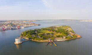 Governors Island and Castle Williams aerial view from New York Harbor, New York City, New York NY, USA.